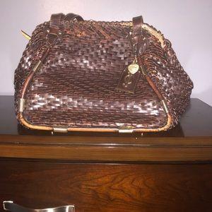 Gently used basket woven hand bag
